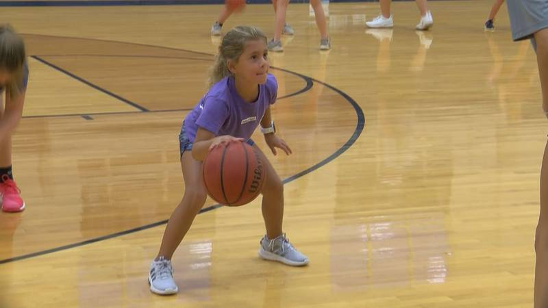 Camper practices dribbling drill at Brookwood basketball camp
