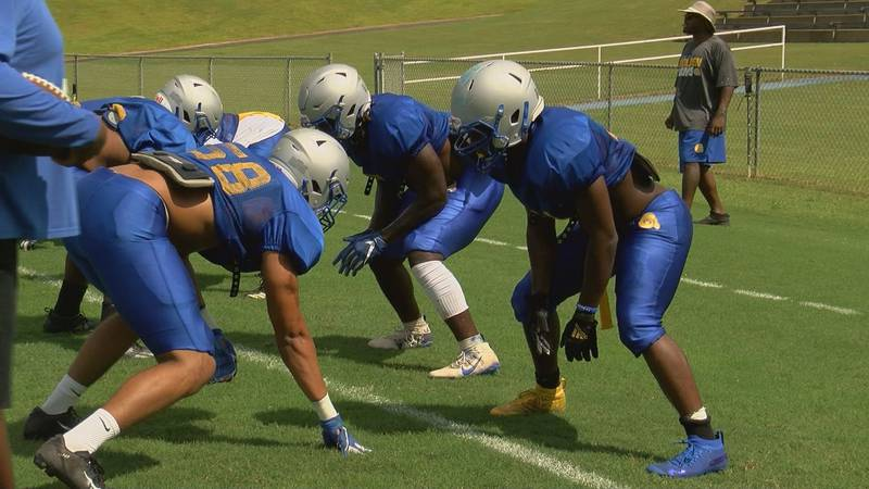 ASU lineman line up for drill during practice