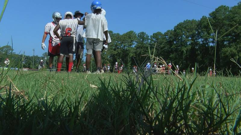 Trojans gather during before opening fall practice