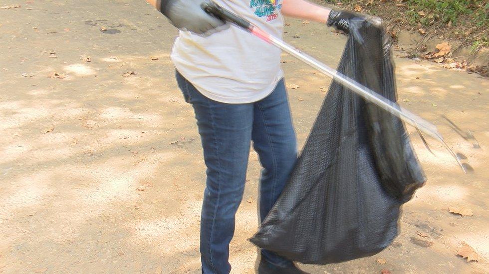 Volunteers picking up trash along the Flint River.