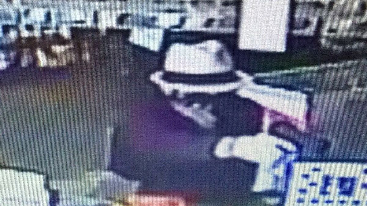 Surveillance video showed Burton entered the store with his face covered and wearing a hat, and...