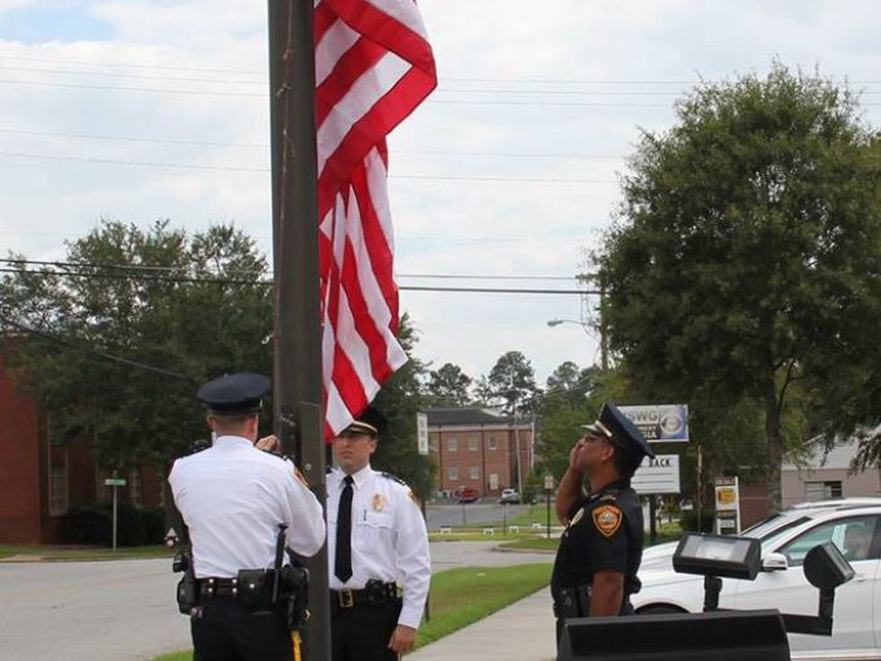 Representative Austin Scott donated the American flag to the city. (Source: Moultrie Police...