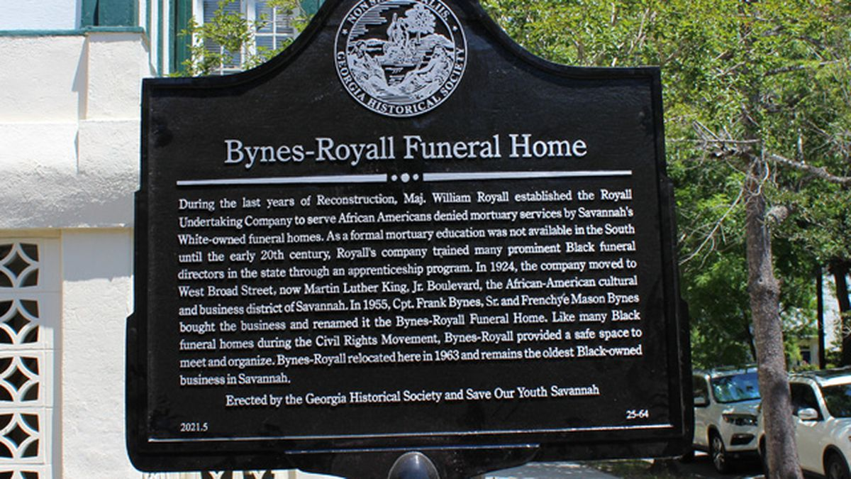 The marker gives historical context to the significance of the funeral home.