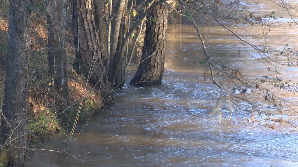 Water rising above the banks of the Kinchafoonee Thursday afternoon. (Source: WALB)