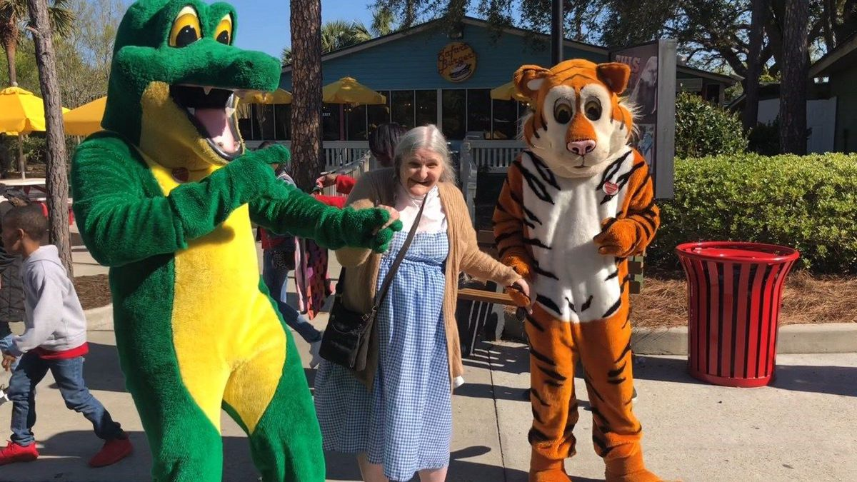 Dorthy Jones dances the day away with some friendly characters! (Source: WALB)