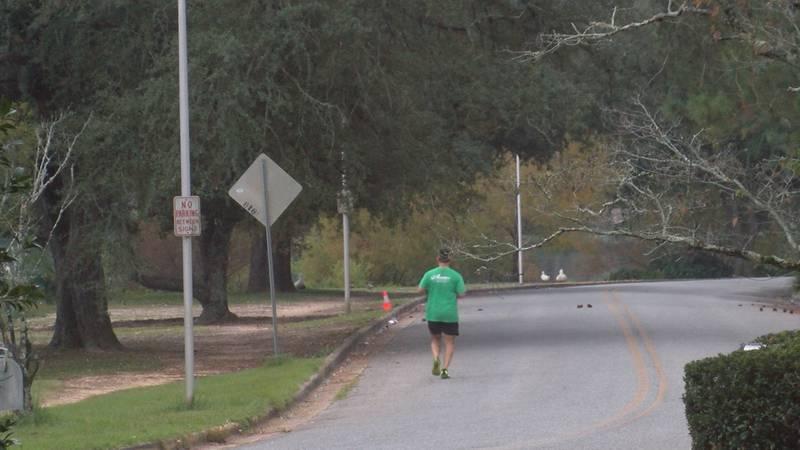 A runner takes his warmup lap around Lake Loretta