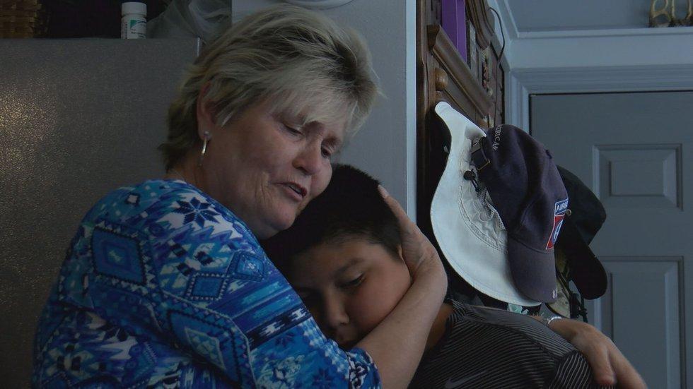 Sarah Radney's grandmother and brother share a hug.