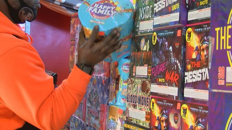 A shopper picks up fireworks at Pyro Zone Fireworks.