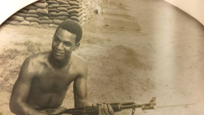 Rance Pettibone, Sr. is pictured cleaning a weapon in Vietnam.