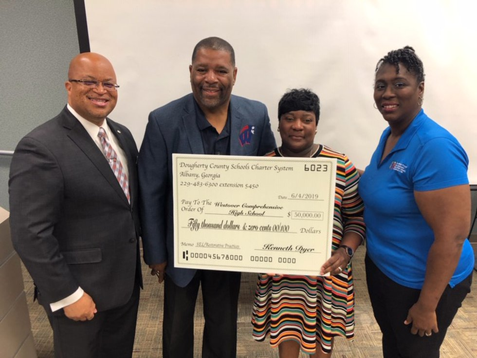 Dougherty County School System supporters accept the grants. (Source: DCSS)