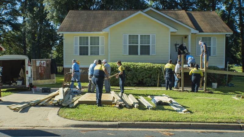 Volunteers help build a ramp for a man in south Albany.