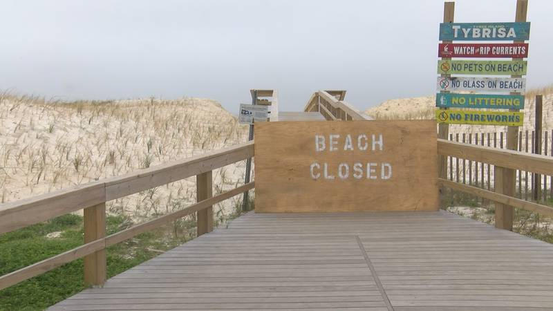 """A plywood sign reading """"Beach Closed"""" bars any visitors from accessing Tybee's sands and waters."""