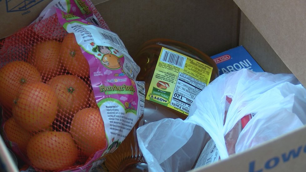 Senior citizens receive disaster food boxes. (Source: WALB)