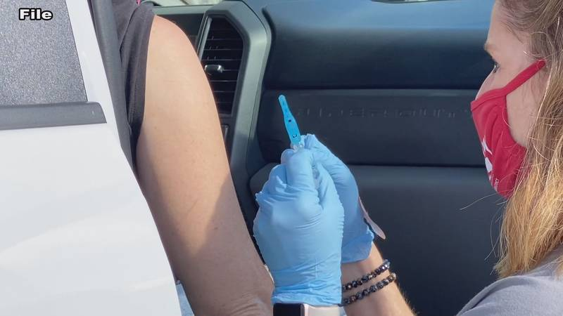 Someone receiving a COVID vaccine.