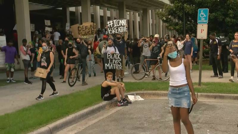 Protesters gather in front of the Civic Center on Sunday.