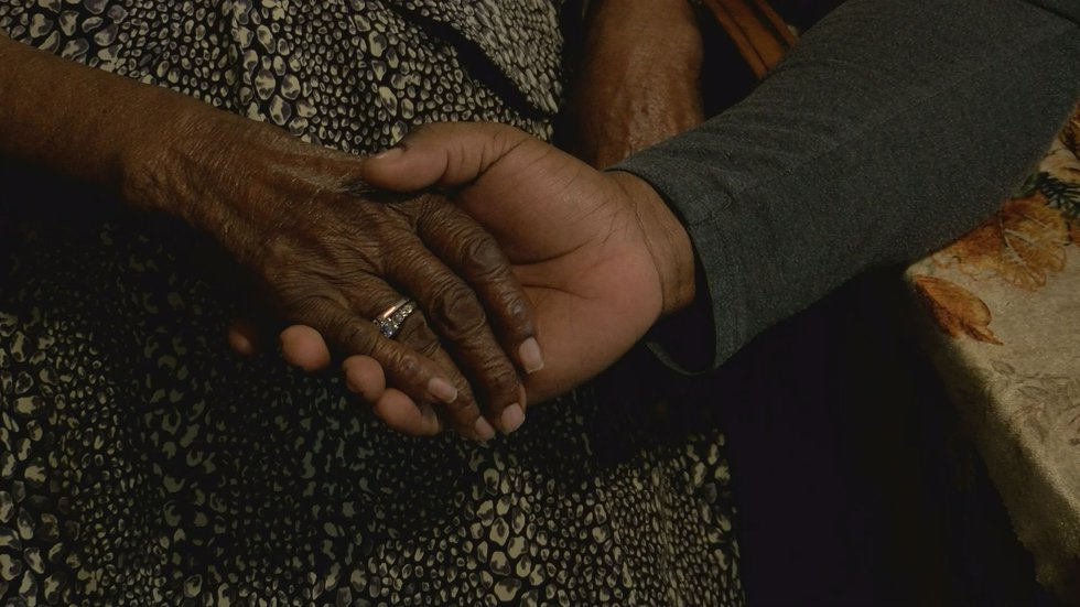 Lucille holding hands with Deacon Smith.