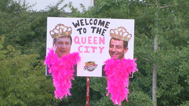 Georgia's Kirby Smart and Clemson's Dabo Swinney on a College GameDay sign in Charlotte.