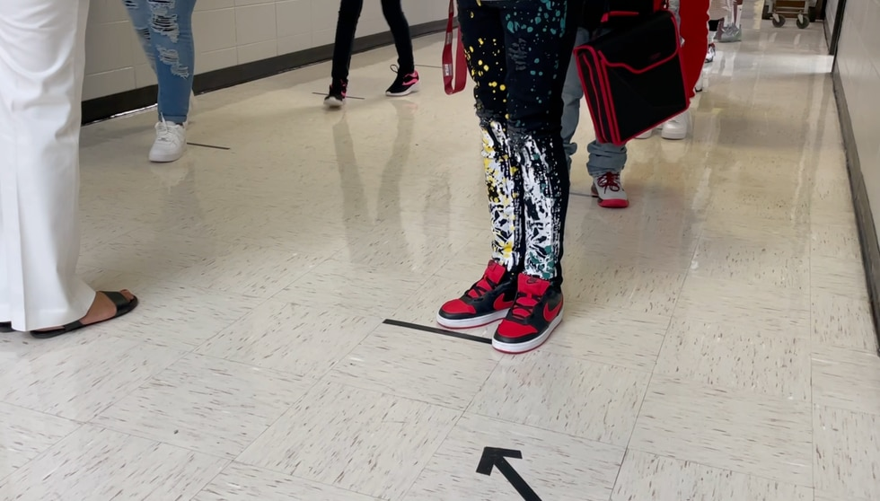 Safety precautions include hallways marked with one-way directions.