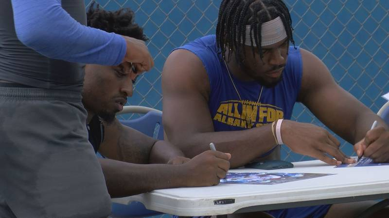 ASU football players sign autographs at fan fest