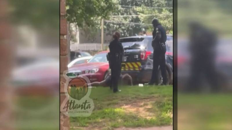 Video shows an Atlanta police officer kicking a handcuffed woman in the head.