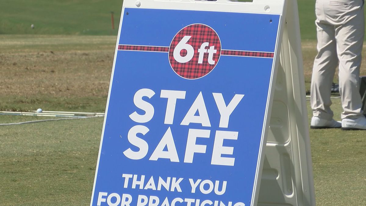 Signs around Harbour Town Golf Links remind those on the course to social distance during the...
