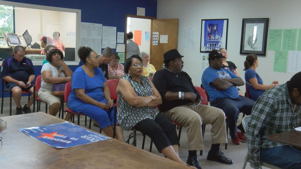 Nearly 1,400 people voted on the first day of early voting,a record number for Lowndes...