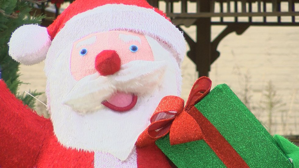 Santa giving away milk and cookies after parade ends