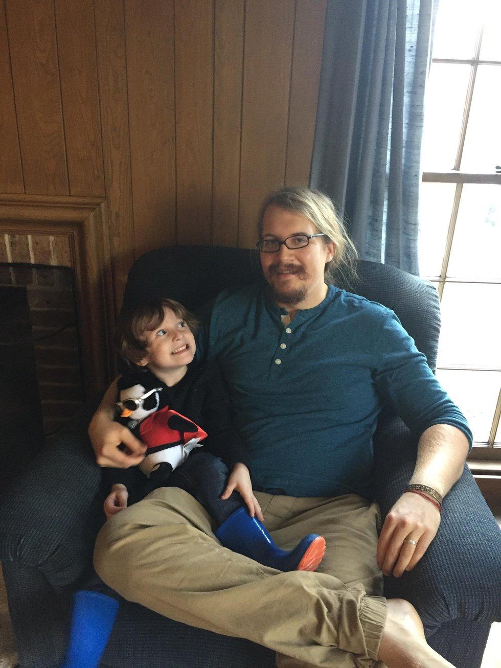 Alex Mixon, robbery victim, sitting with child   (Source-Taylor Mixon)