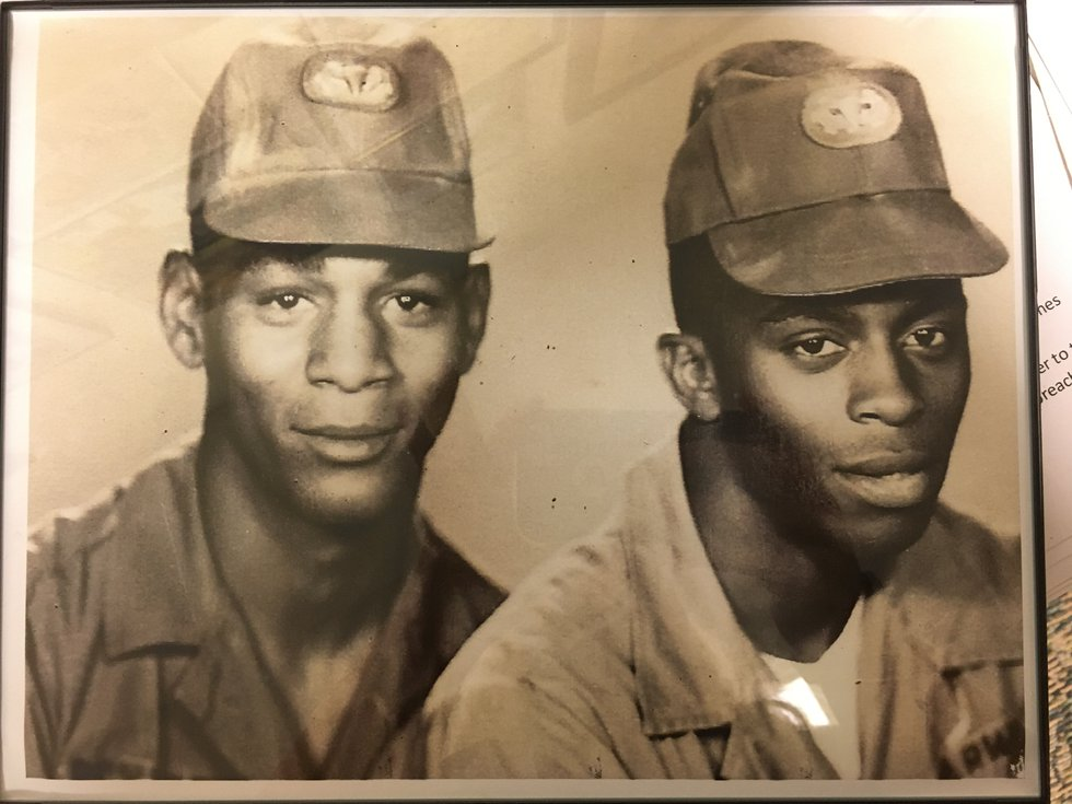 Pettibone (left) is pictured with one of the armor-bearers who he credits with saving his life.