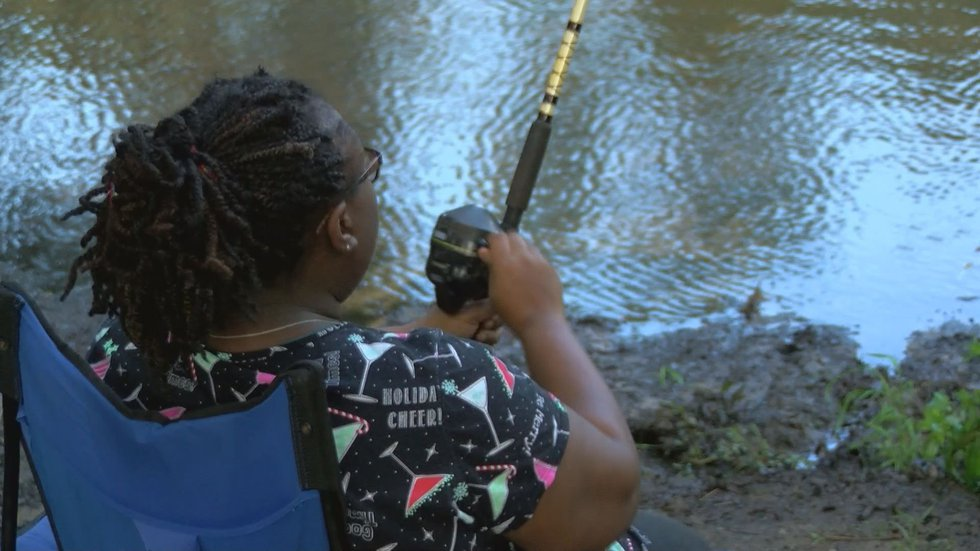 A woman spends the Labor Day holiday fishing. (Source: WALB)