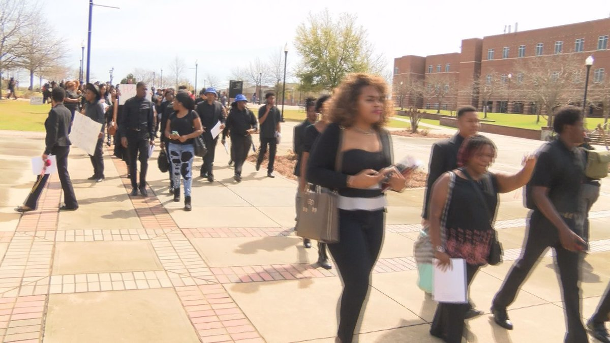 Students marching the campus in protest (Source: WALB)