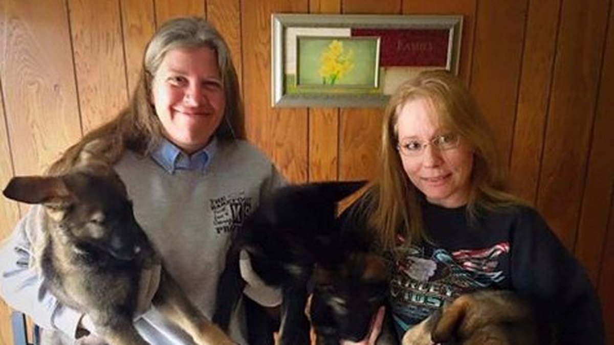 Dee Brown (right) said she donated six puppies to the Barefoot K9 Project to be trained as...