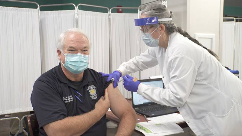 Sam Allen, Director of Emergency Medical Services gets vaccinated
