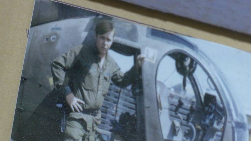 Jackson is shown next to the helicopter he flew in in Vietnam.