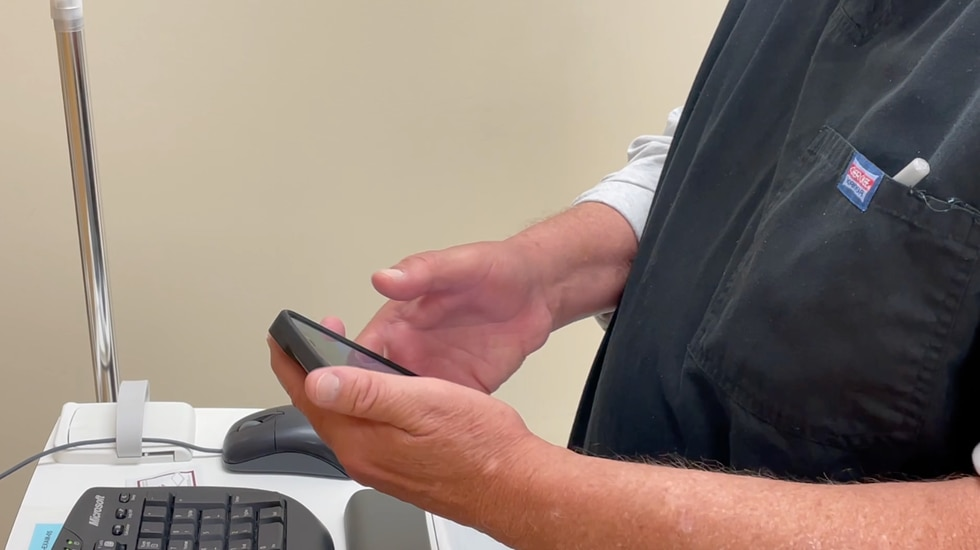 Partnership health center collects phones for patients.