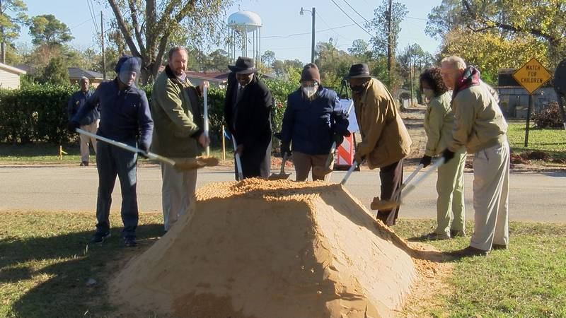Dougherty county commissioners, staff, and residents broke ground at the intersection of Redbud...